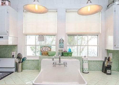 the all white kitchen at dutton waller cottage, mermaid cottages, tybee island ga